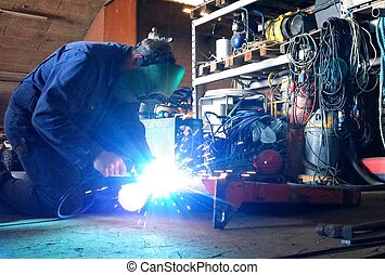 welding in the workshop - Welder in work with welding in the...
