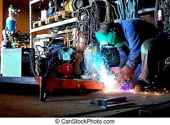 welding in the workshop - Welder in work with welding in the...