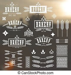 Design elements and logo for bakery. White print on a...