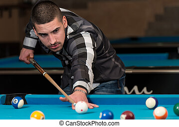Smiling Happy Man Playing Billiard - Young Man Lining To Hit...