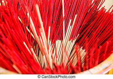 red  incense in a buddhist temple