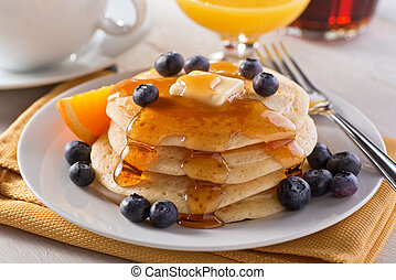 Blueberry Pancakes - A plate of delicious pancakes with...