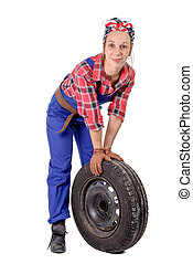 young woman mechanic with a car wheel