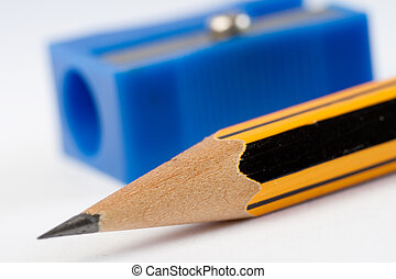 Sharp pencil and pencil sharpener - Very sharp pencil and a...
