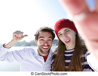 Young couple taking selfie and making faces - Close up...