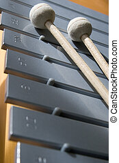 Metalophone with drumsticks - A Metalophone and its...