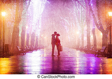 Couple with suitcase kissing at night alley.