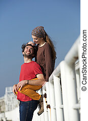 Happy young couple smiling together - Side view portrait of...