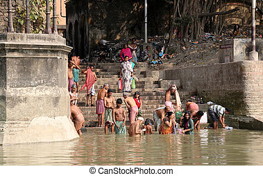 Dakshineswar Kali Temple in Kolkata - Hindu people bathing...
