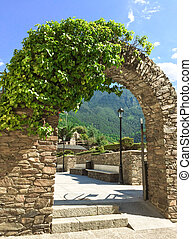 Stone arch in the historic center of Andorra La Vella,...