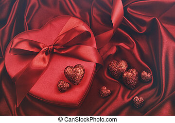 Hearts for valentines Day on satin background