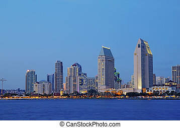 Partial skyline of San Diego over water at night - HDR image...