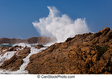 Wave backing against rocks in Sardinia, Italy