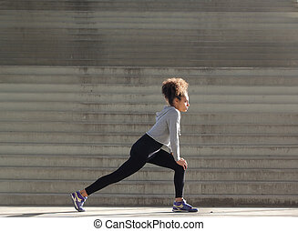 Young woman stretching workout - Side view portrait of a...