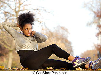 Healthy young woman doing sit ups