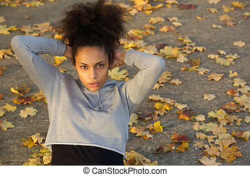 Beautiful young black woman doing sit ups