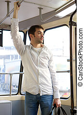 Young man commuting by tram