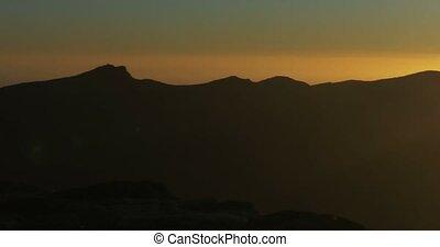 4K, Sunrise at Roque De Las Muchach - Long pan at Roque De...