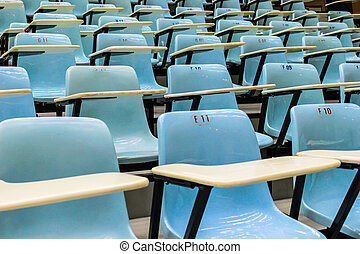 row stack of chairs in lecture room
