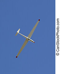 glider - a lone glider in a bright blue clear sky