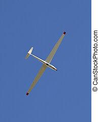 glider - a lone glider in a bright blue clear sky