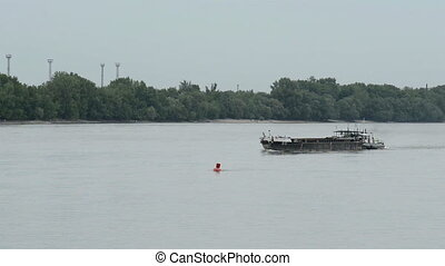Big cargo ship on the water moving - Big Industrial cargo...