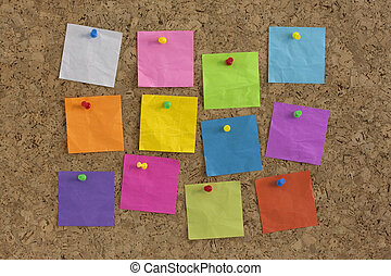 colorful blank notes on cork board