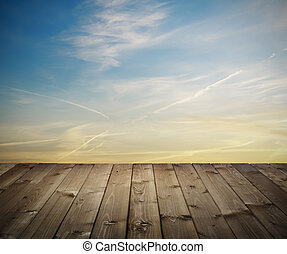 wooden planks at sunset - platform of the old wooden planks...