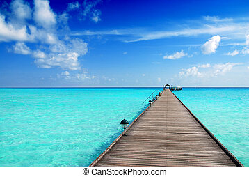 Jetty in the Maldives - Wooden jetty over the beautiful...