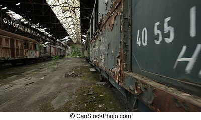 Cargo trains in old train depot glidecam footage - Cargo...