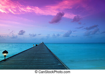 Sunset in the maldives - Beautiful sunrise over the sea and...