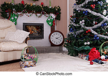Decorated holiday home decor with fireplace and Christmas...