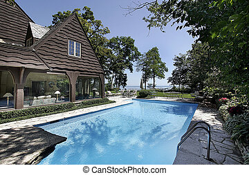 Swimming pool with lake view - Swimming pool in luxury home...