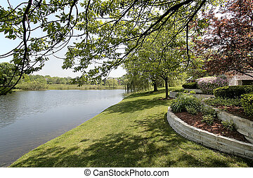 Back yard and lake of luxury suburban home