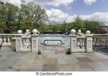 Stone patio and pool - View of stone patio and swimming pool