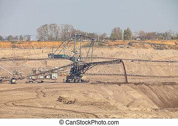 Opencast brown coal mine. Giant excavator. - Open pit....