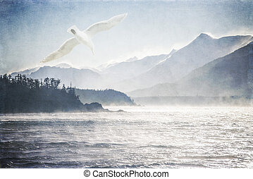 Seagull and the Sea - Seagull flying over rough sea on a...