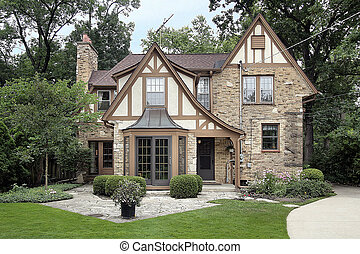 Brick home and stone patio - Rear view of brown brick home...