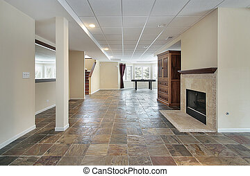 Basement in luxury home with stone floor