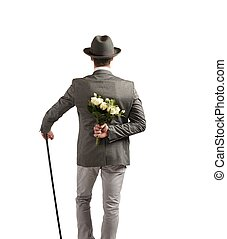 Gentleman gives a bouquet of white roses