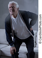 Senior man having back pain - Photo of senior man having...