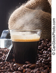 Espresso coffee in glass cup with coffee beans - Espresso...