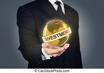 Businessman holding a golden globe with investment text -...