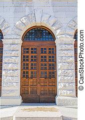 wooden portal of an italian palace