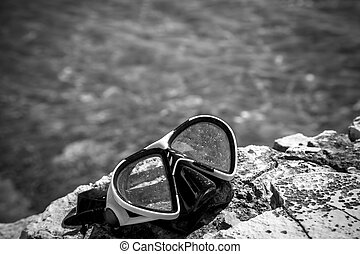 diving goggles on the beach