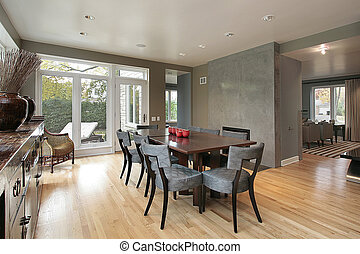 Dining room in luxury home with view to patio