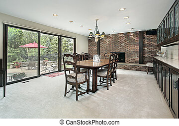 Dining room with brick fireplace