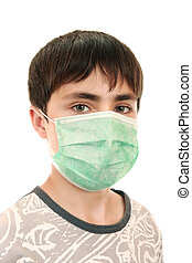 15-year-old boy in the medical mask - The teen uses a means...