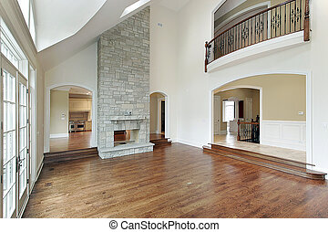 Family room with two story fireplace - Family room in new...