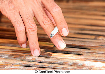 man hand hold smoking cigarette
